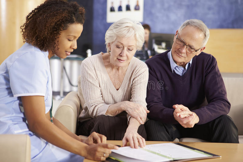 Senior Couple Meeting With Nurse In Hospital royalty free stock images