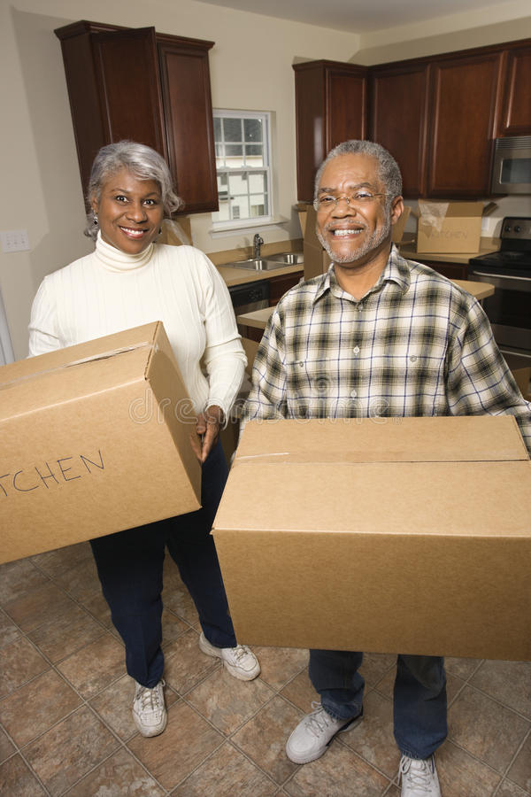 Download Senior Couple With Moving Boxes Stock Photography - Image: 12658202