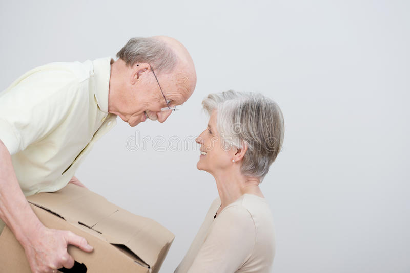 Senior couple moving to a new home stock photography