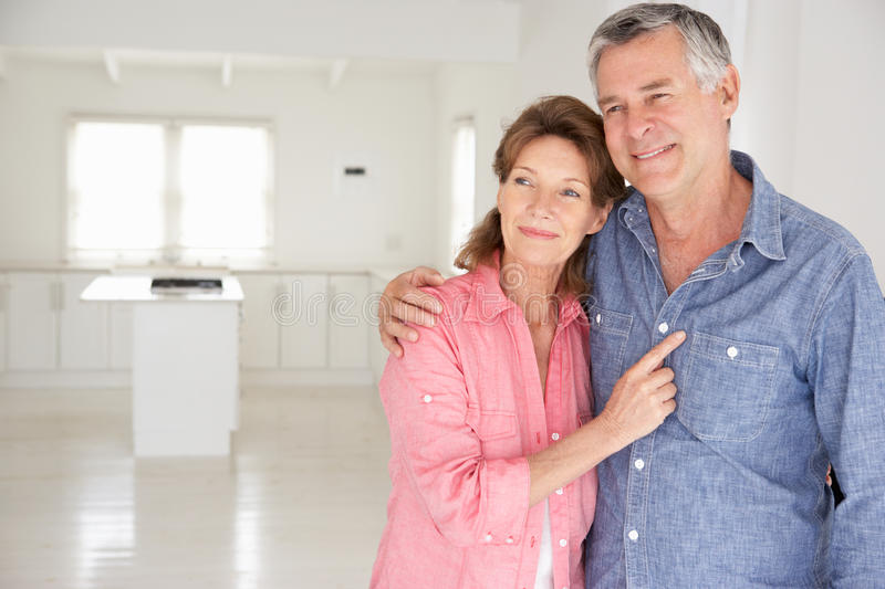 Senior couple in new home. Smiling off camera stock images