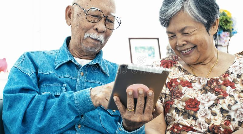 Senior couple online shopping with smile face. Asian Senior couple e-shopping with digital tablet, Senior couple online shopping with smile face royalty free stock images
