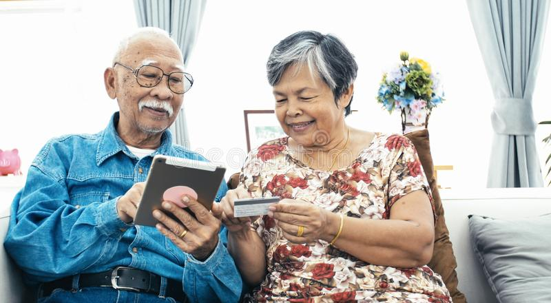 Senior couple online shopping with smile face. Asian Senior couple e-shopping with digital tablet, Senior couple online shopping with smile face stock photos