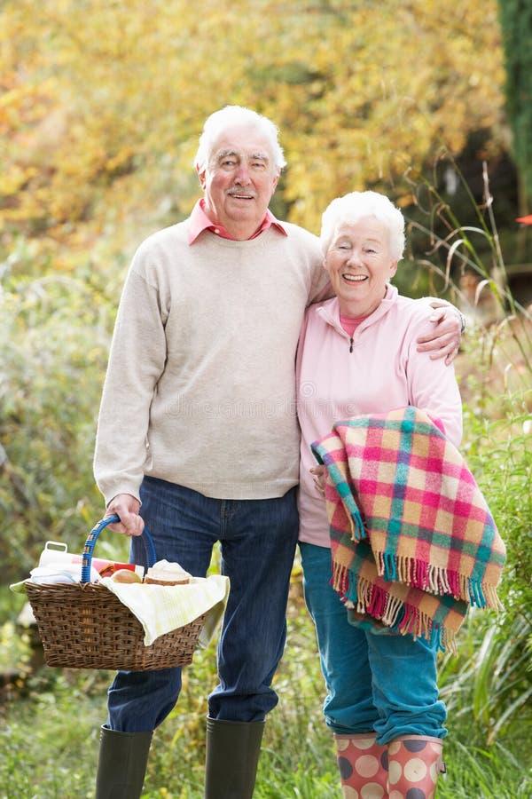 Senior Couple Outdoors With Picnic Basket stock image