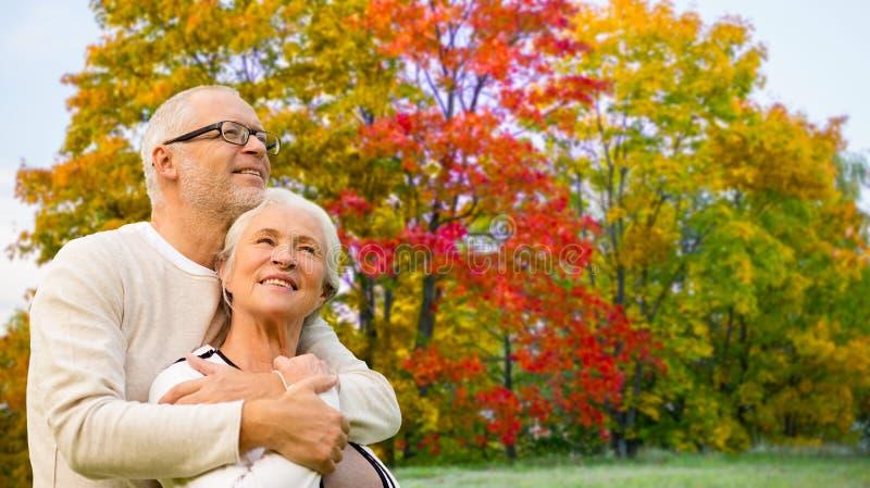 Senior couple over autumn park background stock photos