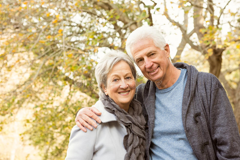 Senior couple in the park. On an autumns day royalty free stock image
