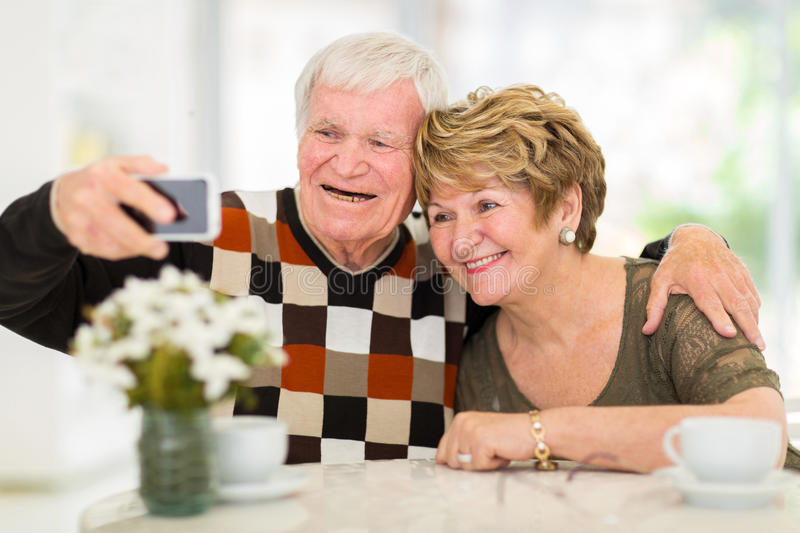 Senior couple phone stock photography