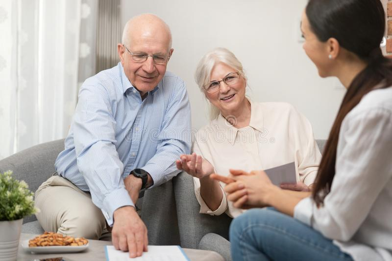 Senior couple planning their investments stock images