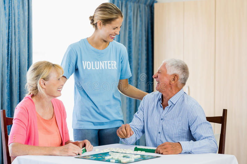 Senior couple playing board games stock images