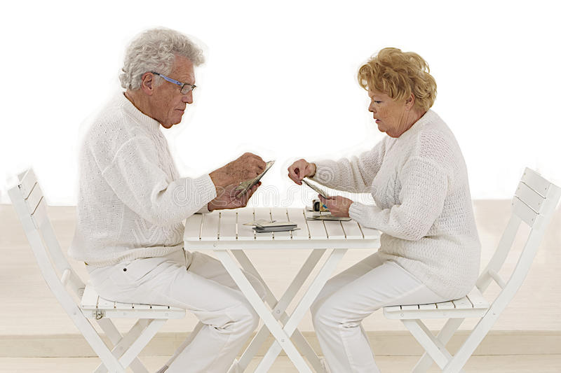 Senior couple playing cards royalty free stock photography