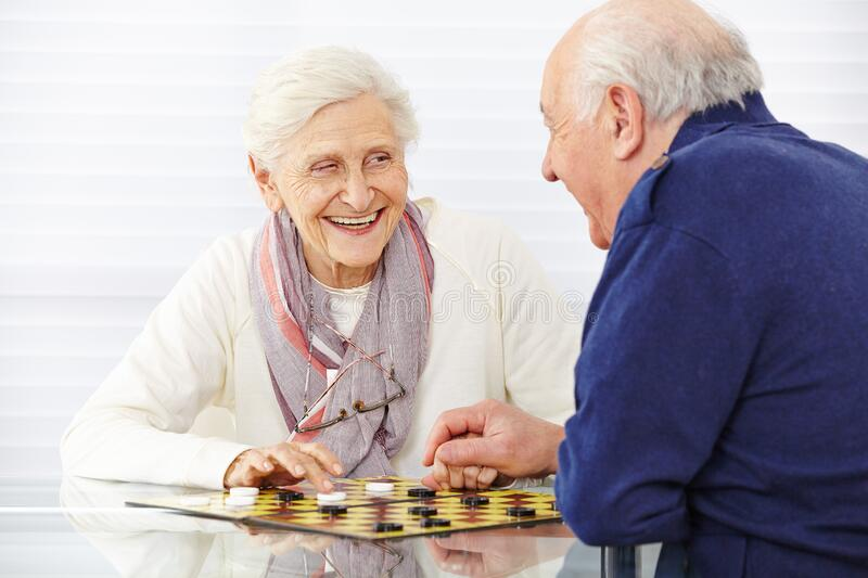 Senior couple plays lady in retirement home stock photography