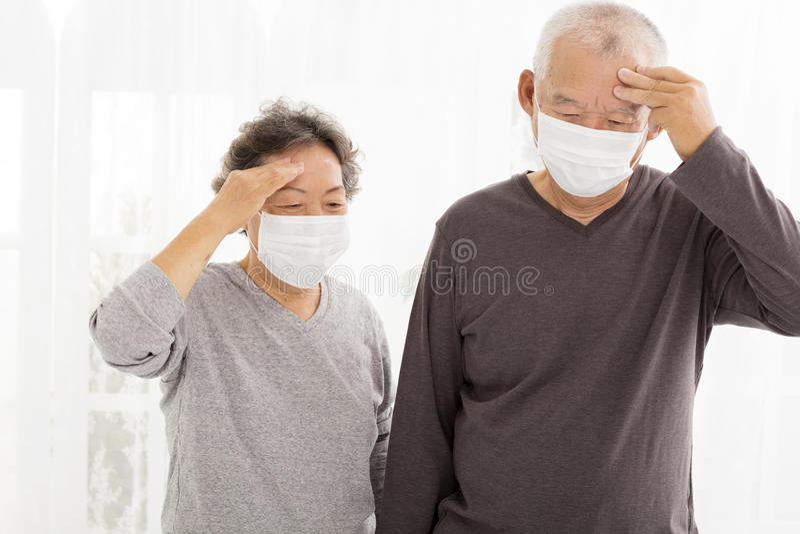 Senior couple with protective face mask. Senior asian couple with protective face mask royalty free stock photos