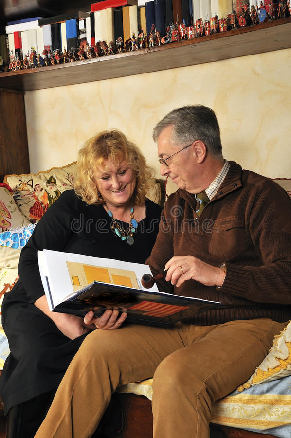Senior couple reading a book. A senion couple is reading a book stock image