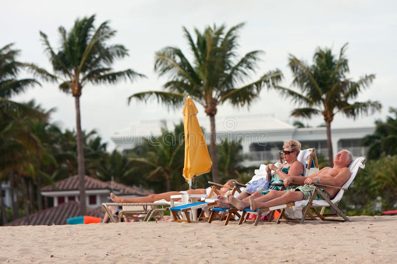 Download Senior Couple Relaxes In Beach Chairs At Florida Resort Editorial Stock Photo - Image: 37953513