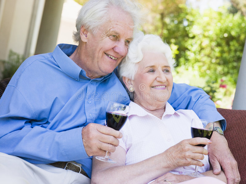 Senior couple relaxing with glass of wine royalty free stock photos