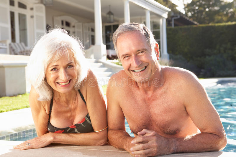 Download Senior Couple Relaxing By Outdoor Pool Royalty Free Stock Images - Image: 14927799