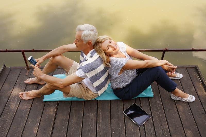 Senior couple relaxing outdoor stock photo