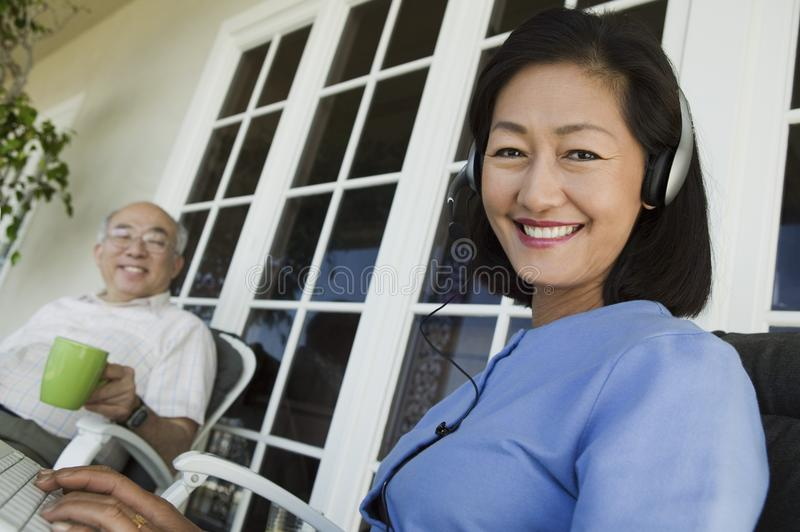Senior couple relaxing on porch stock images