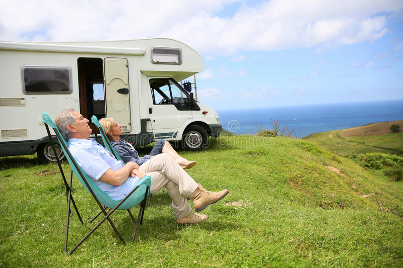 Senior couple relaxing on the seaside. Senior couple relaxing in camping folding chairs, sea landscape royalty free stock photo