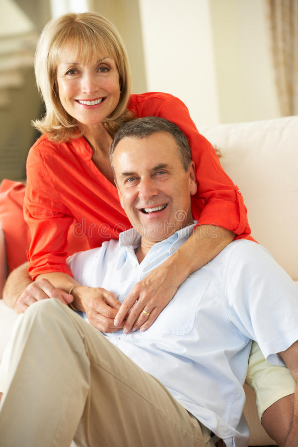 Download Senior Couple Relaxing On Sofa At Home Stock Photo - Image: 26614974