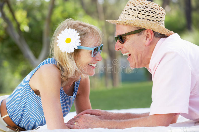 Download Senior Couple Relaxing In Summer Garden Stock Photo - Image: 26616648