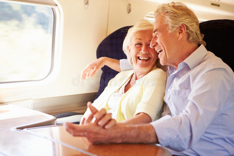 Senior Couple Relaxing On Train Journey royalty free stock images
