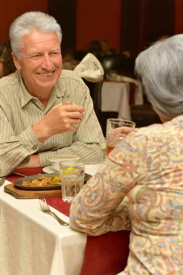 Senior couple in restaurant. Having romantic dinner stock photo