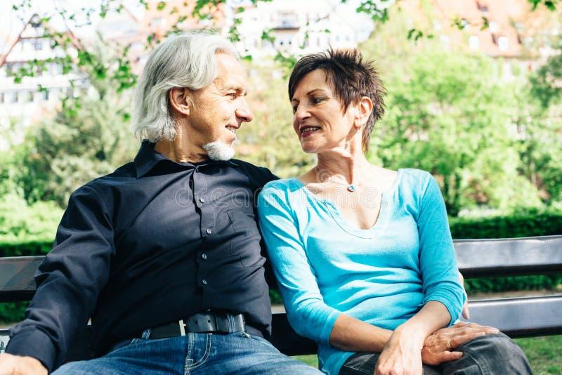 Senior Couple Resting In A Park, Tuebingen royalty free stock image