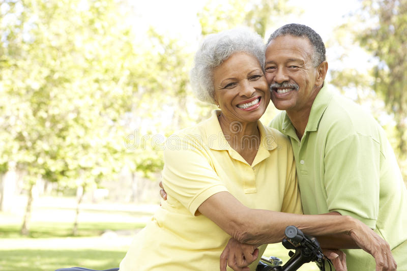 Senior Couple Riding Bikes In Park Stock Images