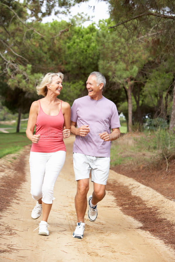 Senior Couple Running In Park Royalty Free Stock Photography