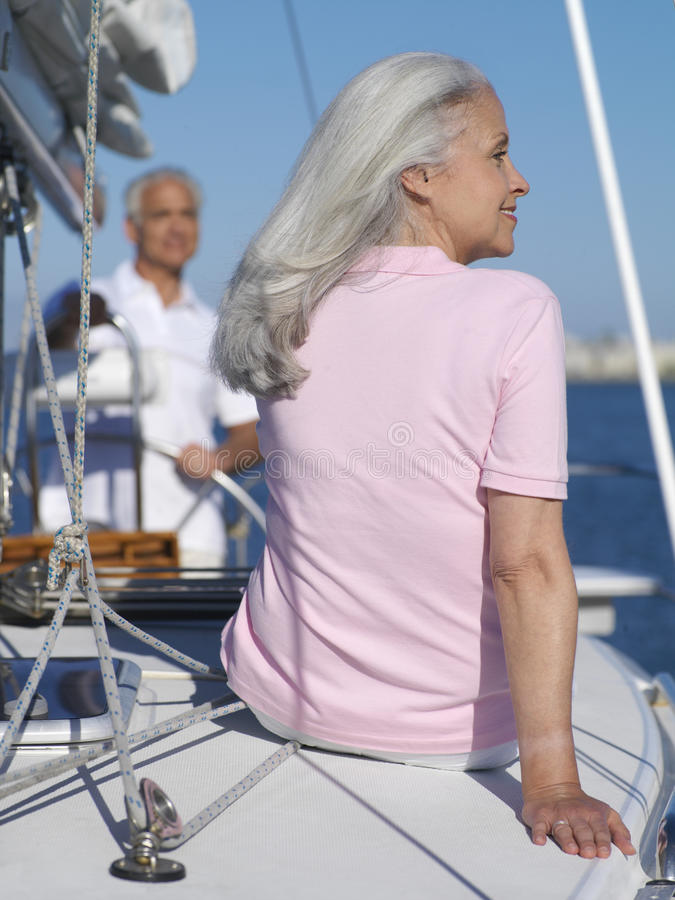 Senior couple on sailing boat, rear view of woman stock photo