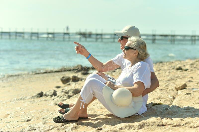 Senior couple at sea. Active cute senior couple at sea in sunglasses royalty free stock photo