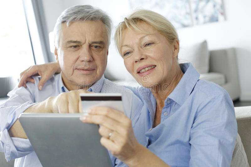 Senior couple shopping on internet royalty free stock image