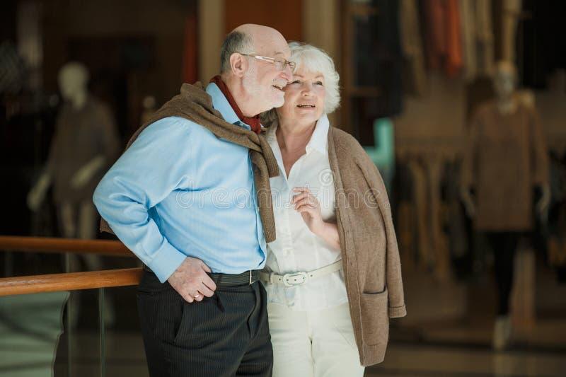 Senior couple in shopping mall stock photo