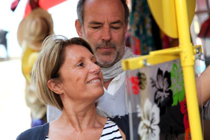 Senior couple shopping in souvenir shop. Senior couple doing shopping in souvenir shop stock photo