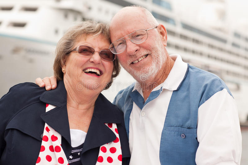 Download Senior Couple On Shore In Front Of Cruise Ship Stock Photo - Image: 17918820