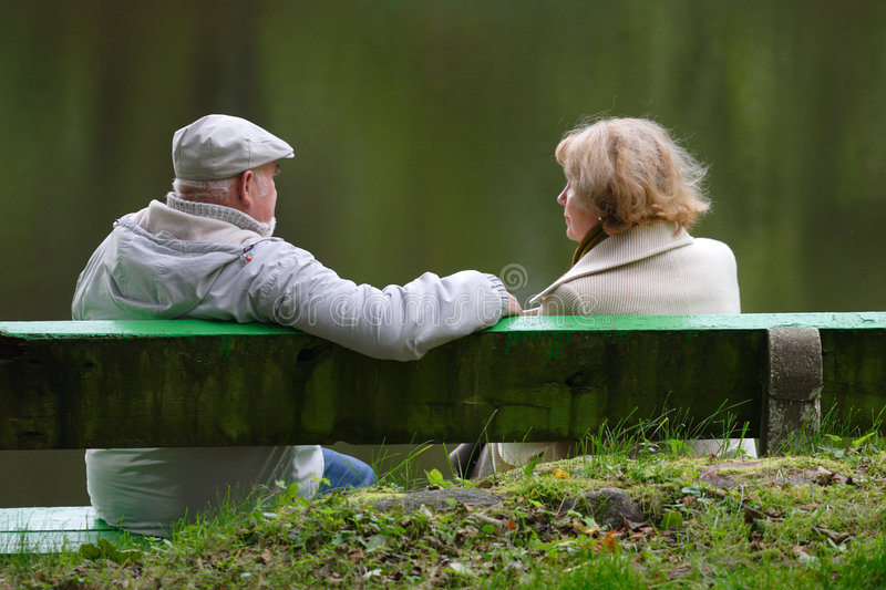 Download Senior Couple Sitting On A Bench Royalty Free Stock Photo - Image: 6700385