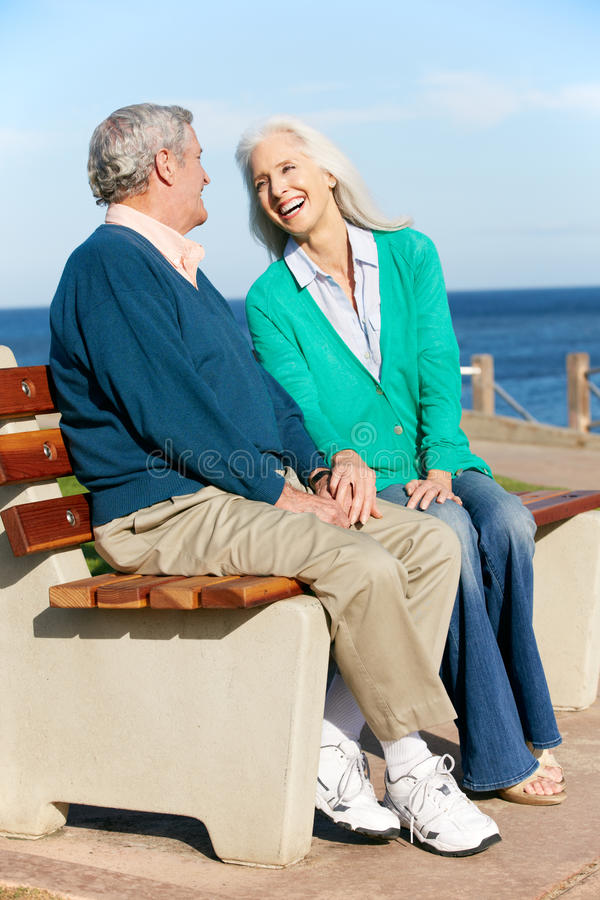 Download Senior Couple Sitting On Bench By Sea Together Stock Image - Image: 27957077