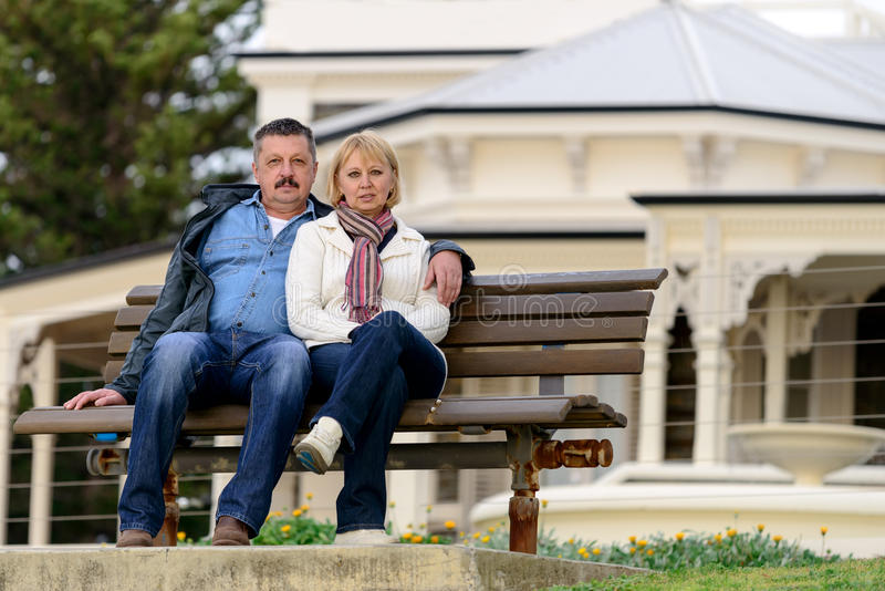 Senior couple sitting on the bench royalty free stock image