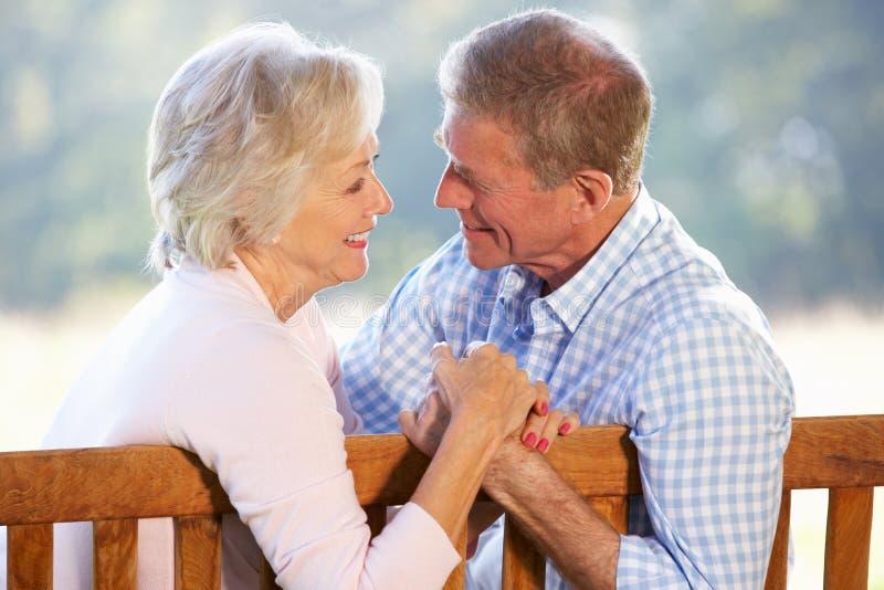 Download Senior Couple Sitting Outdoors Stock Photo - Image: 25391414