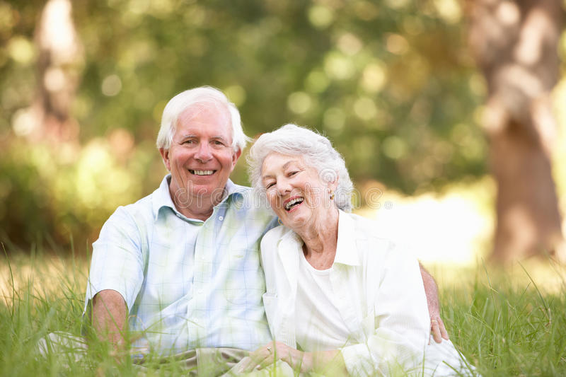 Senior Couple Sitting In Park stock image