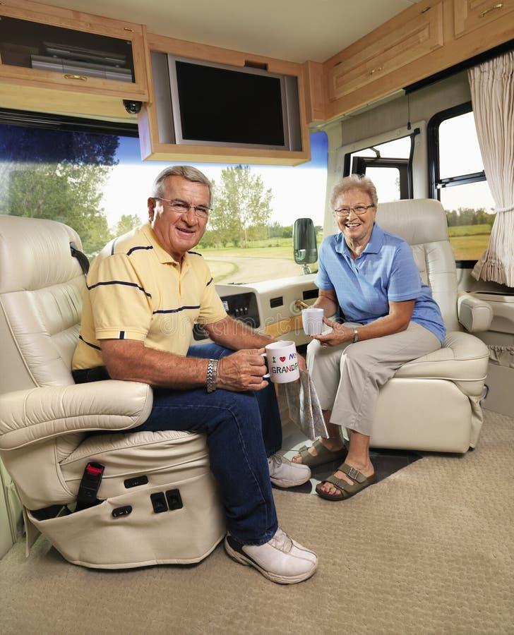 Senior couple sitting in RV. stock image