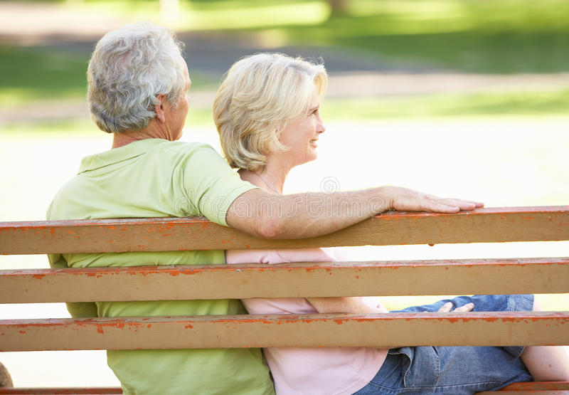 Download Senior Couple Sitting Together On Park Bench Stock Image - Image: 14640357
