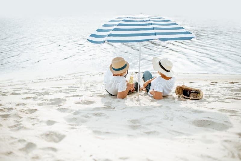 Senior couple on the beach stock photos
