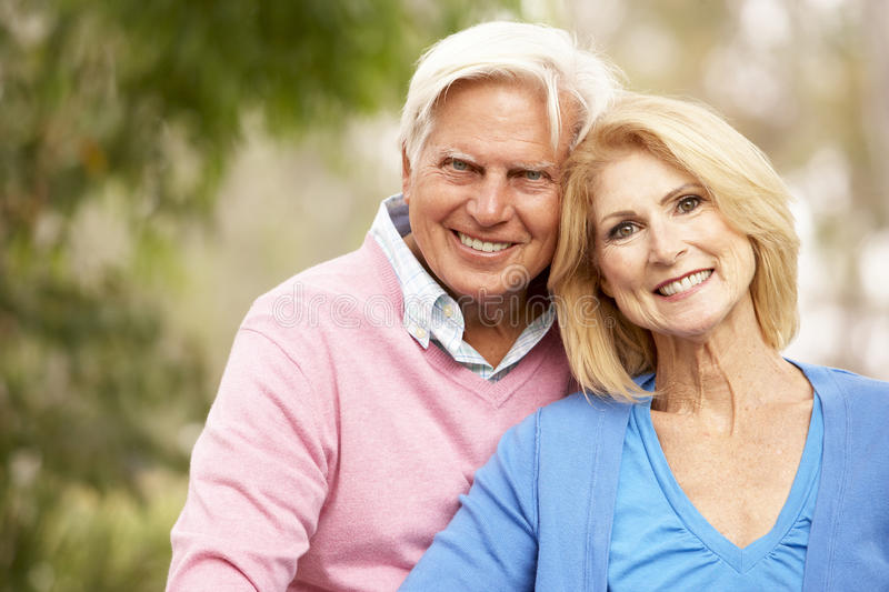 Senior Couple Sitting On Wall royalty free stock photo