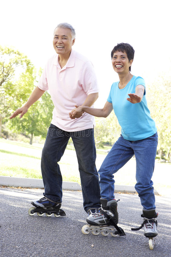Senior Couple Skating In The Park royalty free stock image