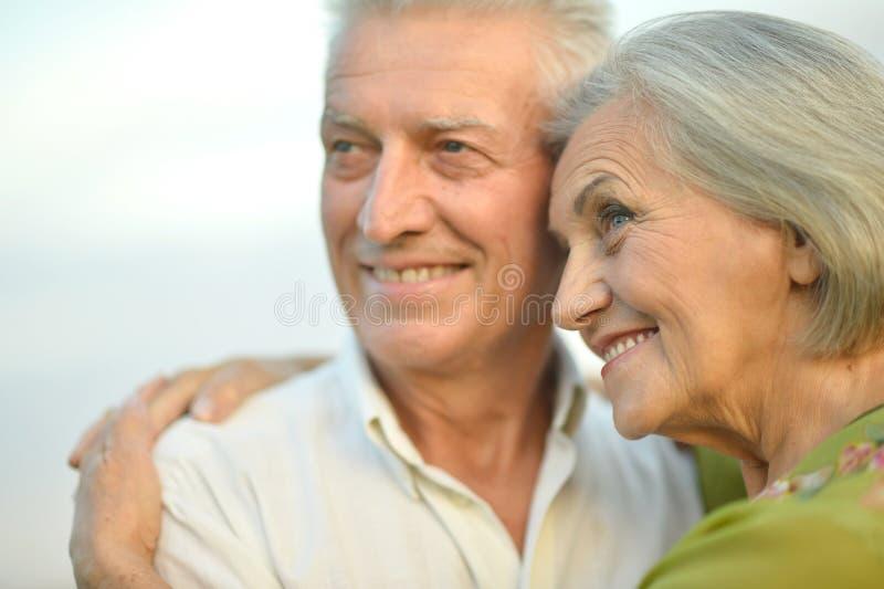 Senior couple on sky background. Happy senior couple on a sky background royalty free stock photo