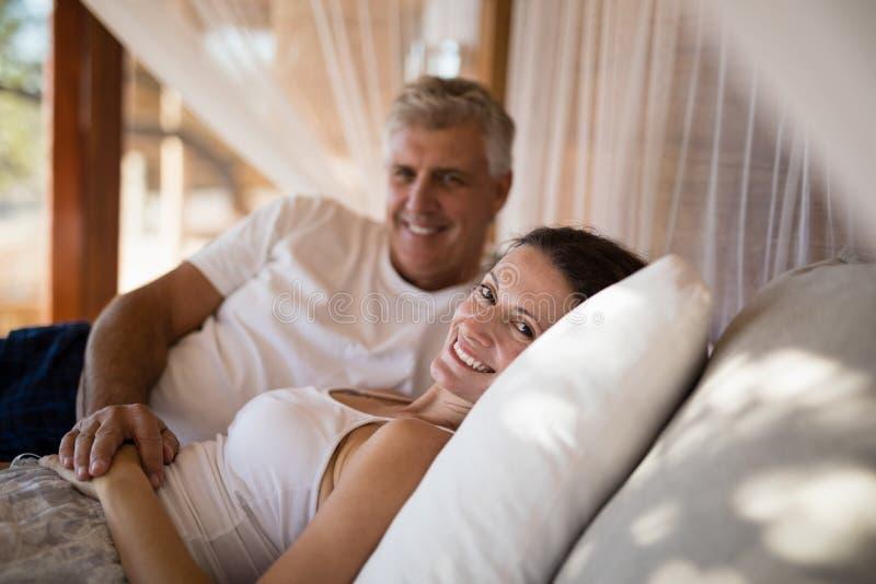 Senior couple sleeping on canopy bed stock photo
