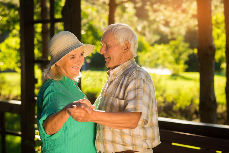 Senior couple smiling and dancing. royalty free stock photos