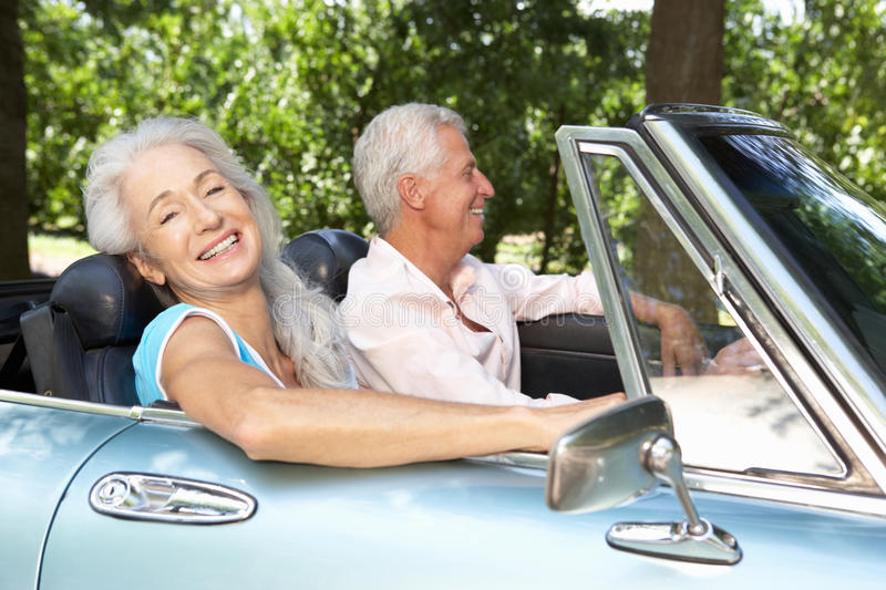 Senior couple in sports car stock images