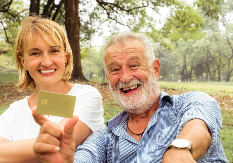 Senior couple stading with insuarence card, Happy life stock image